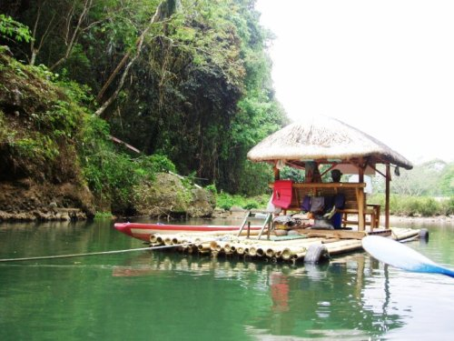 "A ""balsa"" (a raft made of bamboo) with a nipa hut floating on the Pagsanjan river."